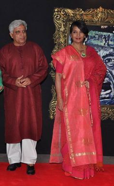 Javed Akhtar walked in with his wife Shabana Azmi who looked elegant in a coral sari and shawl thrown over her shoulders.