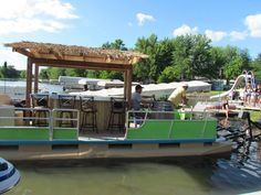 Tiki hut my dad and tim harris built! They bought the pontoon for 500 bucks and turned it into this! Pontoon Boat Party, Pontoon Boats, Party Barge, Lake House Plans, Boat Projects, Tiki Hut, Diy Bar, Boat Design, Pontoon Stuff