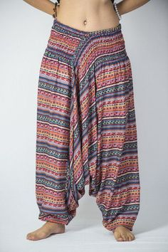 """These magical Low Cut Harem Pants can be converted into a jumpsuit. It's like buying one outfit but getting two. They are great for lazy Sundays, doing yoga, or hula hooping at a music festival. Free international shipping on all orders over $60. Sizing: One size fits most. Measurements: Waist: 24"""" to 38"""" Hips: up to 44"""" Total length: 43"""""""