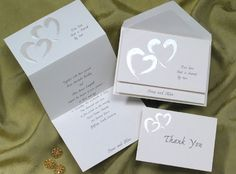 Two tender but modern pearl hearts adorn the front of this soft white invitation. Your names peek out of the bottom and your favorite verse is on the front. #heart