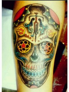 My husband's cyclist sugar skull tattoo by Sebastian at Otherworld Tattoo, Santa Barbara, Ca