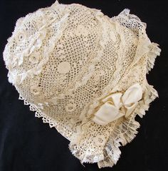 Christening Bonnet of cotton Irish lace and netting.