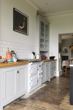 A lovely cooker run painted in a bespoke soft grey. The base cabinets are beautifully simple whilst the tall Classic glazed cupboards are grand and well-proportioned and work so well with the high ceilings and fabulous plaster details.