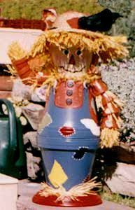 Colorful clay pot scarecrow.