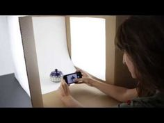 How To Build A Photo Light Box For Less Than $10 - YouTube | Cardboard box, interfacing fabric, poster board, clip lamps, fluorescent bulbs.