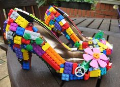 These are SO awesome.  I'd love to do something like this with a pair of heels from Goodwill and trinkets and lego pieces from the kiddos... put them in a shadow box and call it art!  FABULOUS!