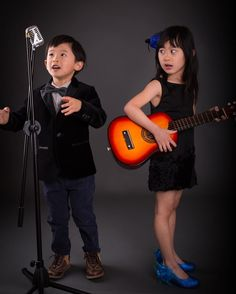 I just realized that I haven't shared lots of fun shots from this band shoot we did in March. This one was a blooper. Audrey was not happy that Wesley messed up the prop vintage microphone. #familylove #siblinglove #studiosession #studiolighting #studioportrait #studiophotography #guitar #childphotography #childrenphotography #bokehstoryphotos #vintagestyle #childfashion #fourtearsold #fiveyearsold #blooper