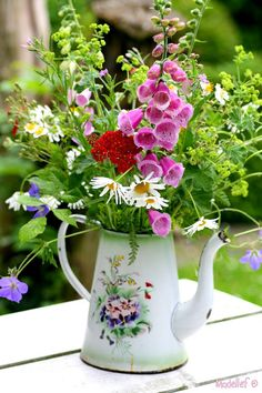 Jug of wild flowers... nice tin teapot, good as a centrepiece for the outside table and chairs.