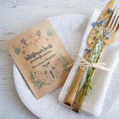 This enchanting design has been illustrated especially for us by local designer Plainly Patterned. Using the softest lilacs, pinks, greens and blues to weave the wildflowers, bees and butterflies, the graphic 'Wildflower seeds for butterflies and bees' and your names and wedding date
