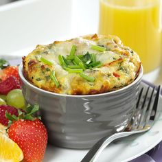 """Individual Italian Frittatas Recipe -The Italian word """"frittata"""" refers to frying the egg-based dish in a skillet. This Italian spin with added salami, roasted sweet peppers and mozzarella is baked in a ramekin but the ending is the same—delicious day or night. —Mrs. Nancy Elliott, Houston, Texas"""