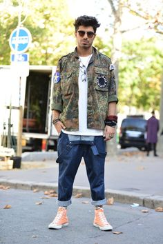 Military jacket + graphic t-shirt + cuffed overalls + sneakers
