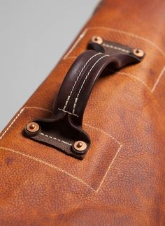 Leather working. Bag handle.