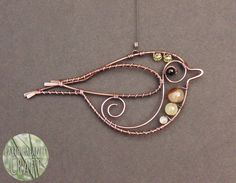 Goldcrest Decoration - This adorable hanging decoration follows the contours of the Uk's smallest bird, the Goldcrest. Made with copper, gemstones and glass