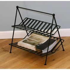 This attractive handmade magazine rack has two shelves for newspapers and magazines. The powder-coated finish protects the stand from rusting and is even weather resistant year round.