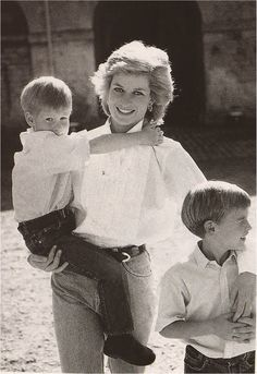 Princess Diana is glowing here with her young sons Prince Harry and Prince William in 1989.