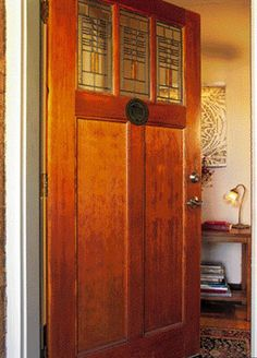 At the front steps of a renovated Chicago bungalow, a Craftsman-style Simpson door invites guests into the home. Preserving art-glass windows is a mainstay of bungalow authenticity.
