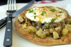 breakfast pizza with homefries, pork roll, cheese & fried egg