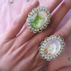 Decorate your delicate digits! Behold these lovely, pastel-y, fantasy rings. Each one features a different combination of cameo, rhinestones, and laser cut cameo setting. They are attached to silver, adjustable band and can fit most finger sizes.  This listing is for one ring. Please choose from unicorn, fox, cat, or bunny.