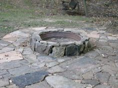 Fire pit. Made from old tractor rim and local creek stone