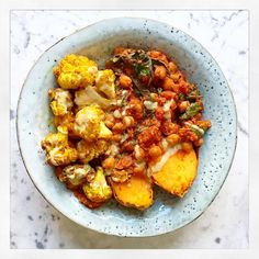 Speedy chickpea chilli with baked sweet potatoes and spiced cauliflower.