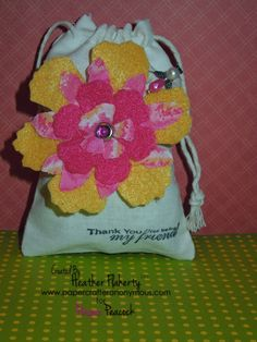 This pretty gift bag was created by Pinquette Heather F. Using Pinque Peacock Layered Fabric Flowers and Beaded Stick Pin