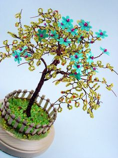 Yellow Blossom Sculpture Wire Tree With Wooden Fence by wireforest