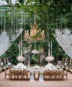 We're in love with the hanging crystal chandeliers, all white palette and abundant ivy at this intimate Maui wedding.