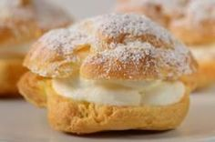 A Cream Puff is a hollow round of crisp choux pastry that is split in half, filled with a loads of whipped cream, and dusted with powdered sugar. Delicious. From Joyofbaking.com With Demo Video