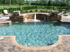 Close in the semicircle for hot tub. Change the brick in the back to stack stone for trickle effect water feature.