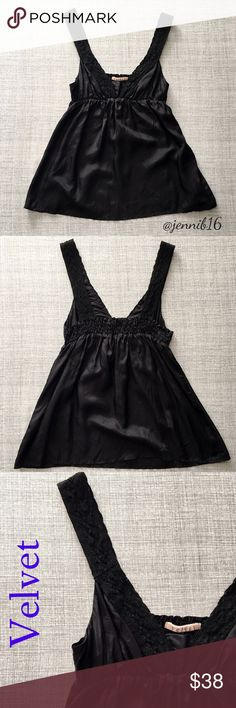 Black satin tank by Velvet ⭐EUC black satin tank. Really flattering and perfect for summer-can be dressed up or down!! Elastic in back and thick straps with subtle tonal braided detailing. Sexy top without showing too much   ⭐️Size small. Brand: Velvet. Can fit up to a medium .   ✅ REASONABLE offers encouraged!  ❌ No trades, lowball offers will be ignored  ✅ Measurements available by request  Bundle discounts available!  Velvet Tops Tank Tops