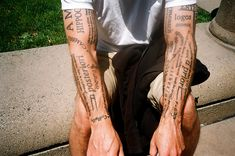 Text tattoos by Josh Blank, via Flickr
