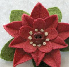 Strawberry colored felt flower pin with vintage button and French knots