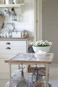 look at this kitchen island made from an old window!!