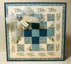 lovely handmade quilt card ... cream and blues ... crochet ribbon ... like the mitered band with stamping/design on it ...