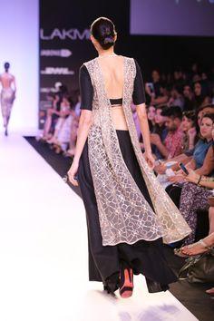RAYNA Black Linen Choli worn with a Stone Net Ogee Embroidered Sleeveless Dupatta  Jacket and Black Linen Ghagra Sharara Pants www.payalsinghal.com/off-the-runway/rayna