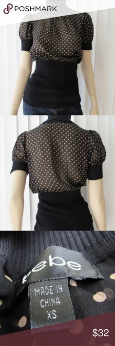 Bebe Polka Dot Turtle Neck Ribbed Hem Silky Blouse *  Silky Polka Dot fabric *  Black ribbed at turtle neck, sleeve & hem *  Pullover style for work, night out or other occasion bebe Tops Blouses