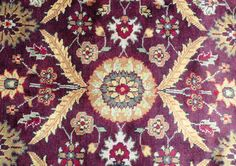 Warm Burgundy and gold wool rug is 5.5'x8.5'.