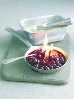 Claire Justine: Flaming cherries jubilee.. recipe and how to flambé. Food on fire - flambé fruit