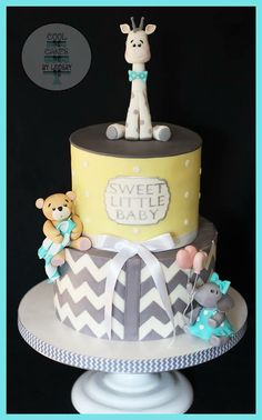 Yellow and grey chevron baby shower cake with giraffe, teddy bear, and elephant. www.coolcakesbylindsay.com
