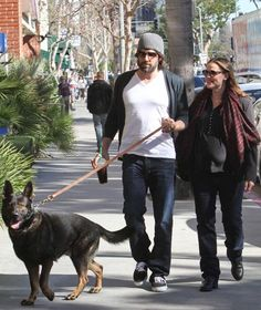 Ben Affleck and Jennifer Garner walk their German shepherd in Brentwood, Calif. The dog is a new addition to the family, which also has a yellow Labrador retriever named Martha Stewart.