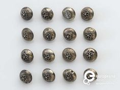 17th century silver buttons with a flower design.