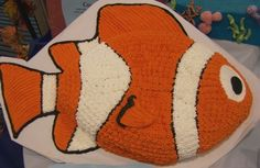 Clown Fish Cake - Finding Nemo Cake - CakeWorksCentral.com  (I made this cake for my sons' second birthday; now I use the football pan for sports cakes.)