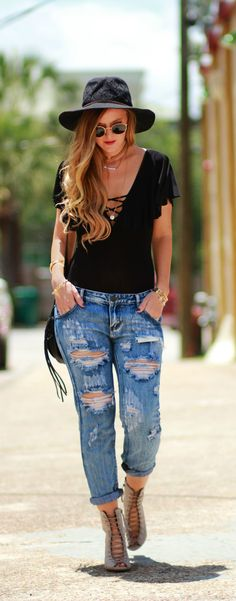 Black bodysuit, distressed boyfriend jeans, and lace up wedges, edgy spring outfit