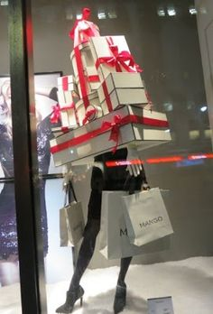 Mango Window Display 2012. Great use of props - and the signage is the company name on the shopping bag in the mannequin's arms