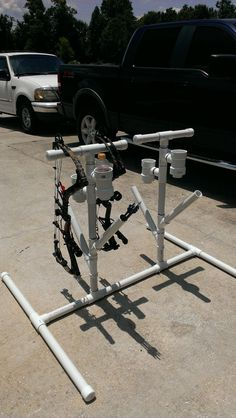 PVC bow stand with quiver and bottle holder.