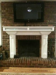 tv above fireplace and mantle