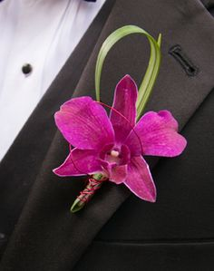 Purple Orchid Boutonniere like the grass behind but in purple