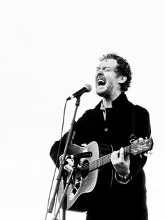 Glen Hansard sings so hard he practically spews his heart out. Love the worn guitar too.
