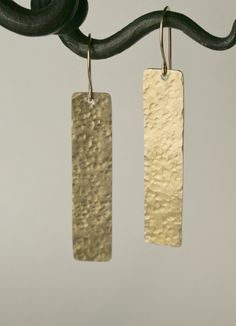 Gold hammered rectangle earrings. Etsy.