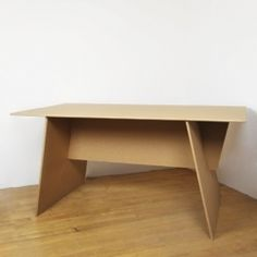 CARDBOARD DESIGNS Cardboard Egologic Dining Table >> NEW YORK, NY >> Pops together for unexpected party guests, doubles as a drawing surface in the playroom, and sits sturdily at the studio for a smooth work surface. Made of recycled (and recyclable) cardboard, these flat-pack pieces of functional furniture are inventive and easy on the planet. Designed to be durable, their clean lines are a perfect neutral base for personalization. 63 x 35.5 x 29 inches when assembled. $165 at NuBe Green